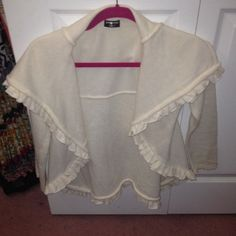 Long sleeve ruffled cardigan long sleeve cream colored sweater cardigan it in rest condition no lent balls or stains  pop coutour Tops