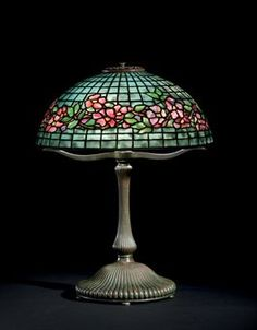 TIFFANY STUDIOS  A 'ROSE BORDER' LEADED GLASS AND BRONZE TABLE LAMP, CIRCA 1910