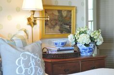 nine and sixteen blog - love a monogrammed pillow. Gold frame, wicker tray, blue and white porcelain