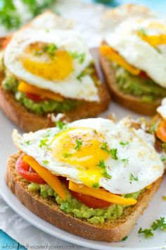 California-Style Fried Egg Avocado Toast - Avocado toast is given a fun California-style twist! This ultimate breakfast toast is piled with lots of smashed avocado, fresh veggies, and a beautiful fried egg on top. Power Breakfast, Protein Packed Breakfast, Breakfast Toast, Brunch Recipes, Breakfast Recipes, Breakfast Ideas, Avocado Toast, Smashed Avocado, Avocado Egg