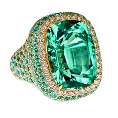 Margot McKinney Couture Jeweller - Sublime is a unique Green Tourmaline 27.94ct, surrounded by Paraiba Tourmalines and Diamonds