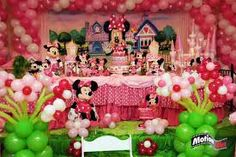 Adorable Minnie Mouse party many balloons pink light pink red and white also many stuffed animals
