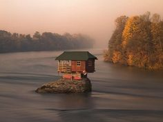 45 Year old tiny Serbian Drina River Home  Floating structures are a great accomplishment, but what about a building that has withstood not only intense Serbian weather but 45 years perched upon a natural rock in a river? This Drina River Home was built in 1968 and is still perfectly situated, minus the exterior wear and tear.