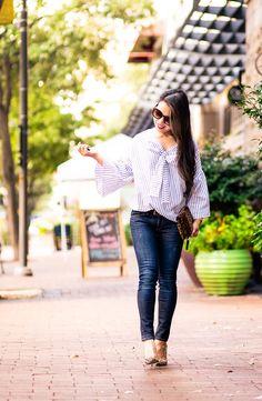 cute & little | petite fashion blog | striped bell sleeve bow top, kendra scott alex earrings, leopard clutch, rag bone jeans, leopard pumps | summer fall outfit