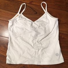 White Lululemon cropped workout top Built in bra. Low V in back and V cut in front also. It's too big on me and never fit right. I wish so badly it was smaller because the style of it is to die for. lululemon athletica Tops Crop Tops