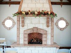 Rustic wedding decorations, fireplace mantel garland at Wadley Farm's