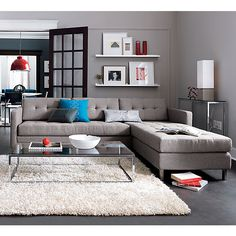 dual pebble tufted sectional in all new | CB2