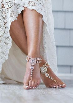 Absolutely breathtaking pair of stunning barefoot sandals. Starla sandals are handcrafted using genuine Kundan Rhinestones along with gold plated chain, stunning rhinestone embedded center piece and adjustable closure on the back. The photos truly do not do this pair any justice. They are