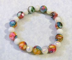 Dyed Mosaic Shell and White Iridescent Glass Bead Stretch Bracelet