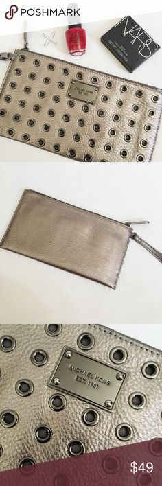 """▪️ SALE ▪️ Michael Kors Colgate Grommet Wristlet Michael Kors Colgate Grommet Wristlet in metallic leather featuring gunmetal grommets and hardware.  Great for a night out, fits cards, lipgloss, cell phone and more!  Like new, only used a few times.  No holes, stains or damage.  ▪️ SALE! $49 marked down to $45!▪️  Measurements: 10"""" W x 5.5"""" H Michael Kors Bags"""