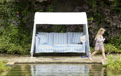 Idler swing seat with oatmeal exterior and blue/taupe stripe interior