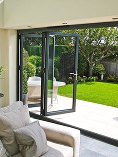 Contact us for a free and no obligation quotation via 01325 381630 or sales Bring the outside in with our Bi-Folding Doors. Aluminium Bi-Fold Doors / Aluminium Bi Folding Doors / Bi-F. Folding Patio Doors, Bifold Doors Onto Patio, Folding Glass Patio Doors, French Doors Patio, Interior Barn Doors, Door Design, House Plans, New Homes, Grey Doors