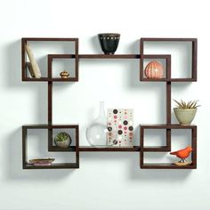 The newest catalog of corner wall shelves designs for modern home interior wall decoration latest trends in wooden wall shelf design as home interior decor trends in Indian houses Small Wall Shelf, Unique Wall Shelves, Wooden Wall Shelves, Wall Shelf Decor, Wall Bookshelves, Bookshelf Design, Shelves In Bedroom, Wall Shelves Design, Floating Shelves
