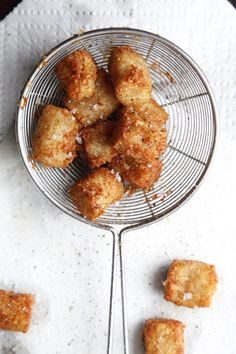 "Tater Tots by Saveur. This recipe comes from chef Michel Richard of Citronelle restaurant in Washington, D. Richard recommends serving the Tater Tots, which he also calls ""spuddies"" with steak. Tater Tot Recipes, Potato Recipes, Homemade Tater Tots, Vegetarian Recipes, Cooking Recipes, Veggie Recipes, Cooking Tips, Side Recipes, Easy Recipes"