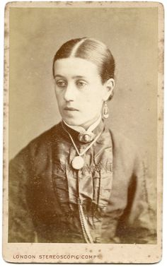 Carte de visite by London Stereoscopic Company. Head & shoulder portrait of a lady wearing jewellery, including earrings, brooch and necklace. The words 'Annie (?) Bob's Aunt' are written on the reverse.