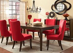 Drama through juxtaposition— the Glamour 7-piece dining set strikingly redefines the formal dining room. Posh pairings such as deep espresso wood finishes and playful curved-back upholstered chairs make an eye-catching statement. The mix of linen-look red fabric against glints of silver in the nailhead trim heighten the glamour.