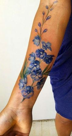 Watercolor Flower Forearm Tattoo Ideas for Women - ideas de tatuaje de antebrazo acuarela flor - www.MyBodiArt.com #armtattoosforwomen #TattooDesignsArm #TattooIdeasForearm #watercolortattooideas #flowertattoosforwomen
