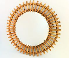 Check out this item in my Etsy shop https://www.etsy.com/listing/198731361/bamboo-sunburst-mirror-french-starburst