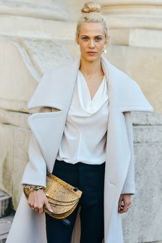 Winter whites on the streets of Paris during Fashion Week.