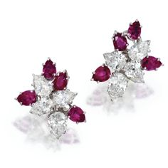 PAIR OF PLATINUM, RUBY AND DIAMOND EARCLIPS, HARRY WINSTON.  Designed as clusters set with pear-shaped diamonds weighing approximately 5.00 carats, and pear-shaped rubies, maker's marks for Harry Winston.