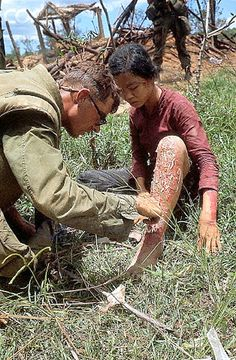 May 16, 1967, Con Thien, South Vietnam - a US Marine treating a Vietnamese girl with leg burns after the Leathernecks swept through her village.