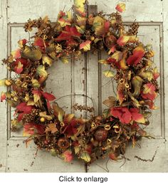 Maple Leaf Silk Wreath - 22 inch      Our Maple Leaf Wreath is made from natural looking autumn foliage and accented with late summer gourds berries and an assortment of late summer florals. Arranged on a woody vine base this wreath is beautiful anywhere in the home but is absolutely perfect on the front door. Measures 22 inches across and 5 inches deep.  $99.00