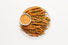 Sweet Potato Fries with Spicy Almond Butter Dip  | This simple side dish can be served as a hot appetizer for a party, a healthy snack or a easy side dish.  I love the almond dipping sauce as it brings a nice change instead of typical creamy dipping sauces.