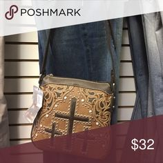 NWT - Montana west cross body new lowered price❤️ Absolutely beautiful- has zippered and phone pocket in the back.  On the inside it has a middle zipper pocket and on one side it has 2 pockets and the other a zipper pocket.  This is an awesome buy at this price considering the retail value is 54.99 Montana West Bags Crossbody Bags