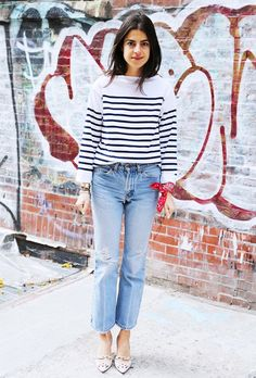 Leandra Medine in a breton top, jeans, and red wrist bandana