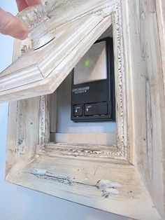 How to hide a thermostat, alarm keypad, etc. by carey Luz No Corredor, Breaker Box, Ugly Things, Cheap Things, Garage Door Security, Garage Door Keypad, Garage Door Opener, Garage Entryway, Garage Door Makeover