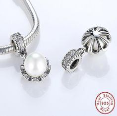 Silver charms Sterling Silver Everlasting Grace White Pearl Charm crafted with 925 sterling silver a perfect charm for the perfect bracelets Silver Hoop Earrings, Drop Earrings, Sparkle, Moon Necklace, Rose, Jewelry Accessories, Fine Jewelry, Pendants, Jewels