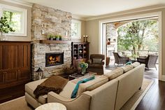 Furnace Street Riverfront - traditional - living room - portland - by Jenni Leasia Design....from houzz.com. I'M LOVING THIS FIREPLACE & THE CONTRAST WITH THE RICH DARK WOOD NEXT TO IT.LOVE THE PAINT COLOR 2