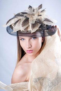 Exclusive feather and sinamay flower headpiece by Irina Sardareva Couture Millinery