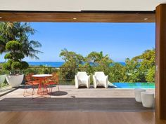 Indoor-outdoor outdoor living design with balcony & latticework fence using grass - Outdoor Living Photo 474359