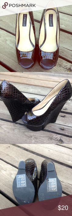 Black gold peep toe wedges EUC Black with gold accent peep toe wedges by Sophia &Lee Size 5.5 and almost 6 1/2 inch heel. Super hot No scuffs or marks. Worn only inside. Love these!! Sophia & Lee Shoes Wedges