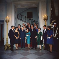 White House reception for Judicial Branch. Front row (L – R): President John F. Kennedy; First Lady Jacqueline Kennedy; Chief Justice Earl Warren; Lady Bird Johnson; Vice President Lyndon Johnson; Nina Warren, wife of Chief Justice Warren; Attorney General Robert F. Kennedy; Ethel Kennedy.