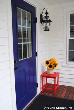 Bouquet of sunflowers on our red eco-friendly polywood side table. PS. We love our new blue doors! :)