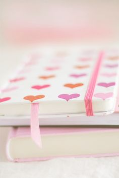 Dreamy pastel coloured heart covered notebook with elastic security band. I want it!