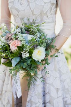 leafy garden rose bouquet, photo by Joseph + Jaime Photography http://ruffledblog.com/vintage-inspired-ontario-wedding #flowers #bouquets #gardenroses