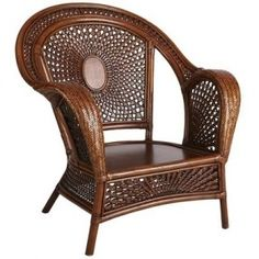 Azteca Armchair from Pier 1. Bent bamboo arms, and a truly beautifully designed back. The chair has an extremely graceful air.