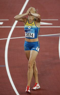 Carolina Kluft Photos - Carolina Kluft of Sweden reacts after she won gold and after the 800 metre discipline of the women's heptathlon on August 21, 2004 during the Athens 2004 Summer Olympic Games at the Olympic Stadium in the Sports Complex in Athens, Greece. - Olympics Day 8 - Athletics
