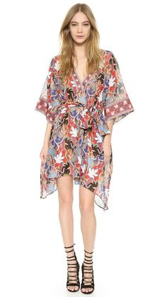 A loose, breezy Antonio Berardi dress with a luxe, bohemian feel. A self-belt gathers the silhouette, and kimono-inspired sleeves finish the look. On-seam hip pockets. Unlined. Semi-sheer.
