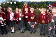 School children from West Kingsdown Primary School cheer Lizzy