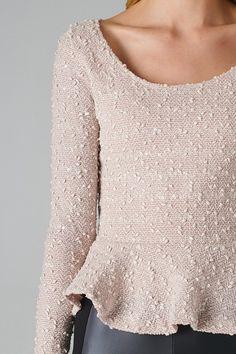 sequined peplum sweater.