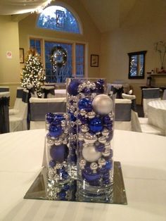 blue and silver wedding centerpieces | even tho its in august this is still a neat idea