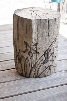 Table or seat from a stump; love the idea of stenciling or pyrography done on it…
