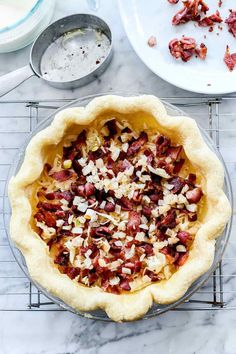 This classic quiche lorraine recipe is an easy make-ahead breakfast, brunch, or lunch made of creamy egg custard, bacon and cheese filling. Goat Cheese Quiche, Bacon Quiche, Make Ahead Breakfast, Breakfast Recipes, Quiche Lorraine Recipe, Simply Recipes, Easy Recipes, Creamy Eggs, Easy Quiche