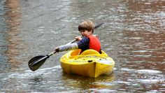 A little boy out rowing in a river in Kent, England. There's so much strength in those eyes! Small Caps, Kent England, Rowing, Sports Equipment, Paddle, Royalty Free Photos, Dream Big, Little Boys, Strength