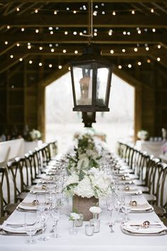 White Centerpieces in Barn Wedding   photography by http://www.ashleyseawellphotography.com/