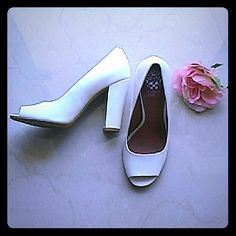 """Vince Camuto Lovely Shoes! Pristine white patent leather with approximately a 3.75"""" chunky heel with the cap. These shoes are a thing of beauty and easy to walk in. Worn once in the house. Well worth the investment! They're lovely! Vince Camuto Shoes Heels"""